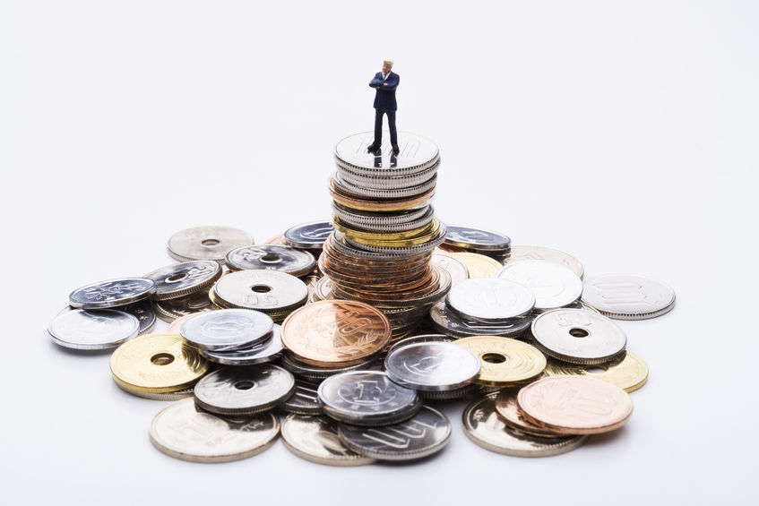 39002098 - the doll business man on top of the stacked coins