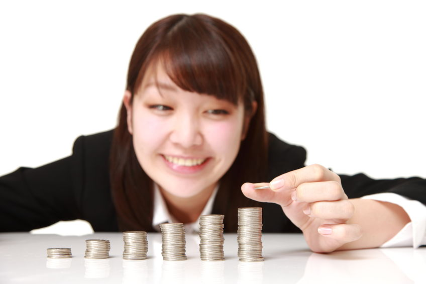 40327072 - businesswoman put coins to stack of coins