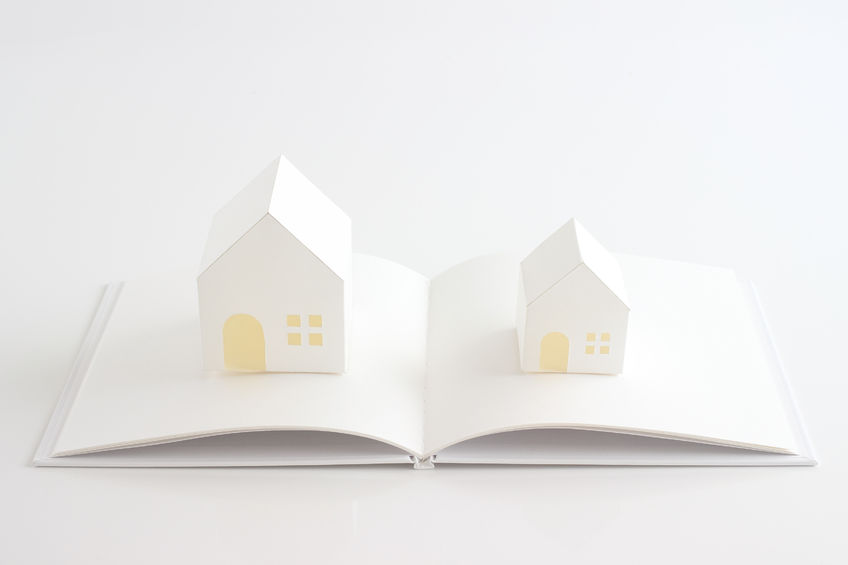 41812142 - toy house and white book on the white background