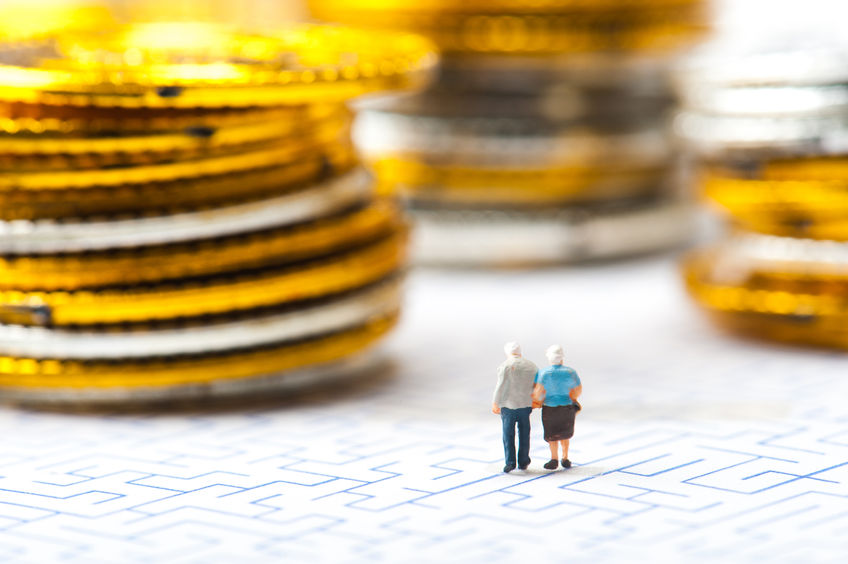 51950133 - couple of elderly walk through the maze, money problems