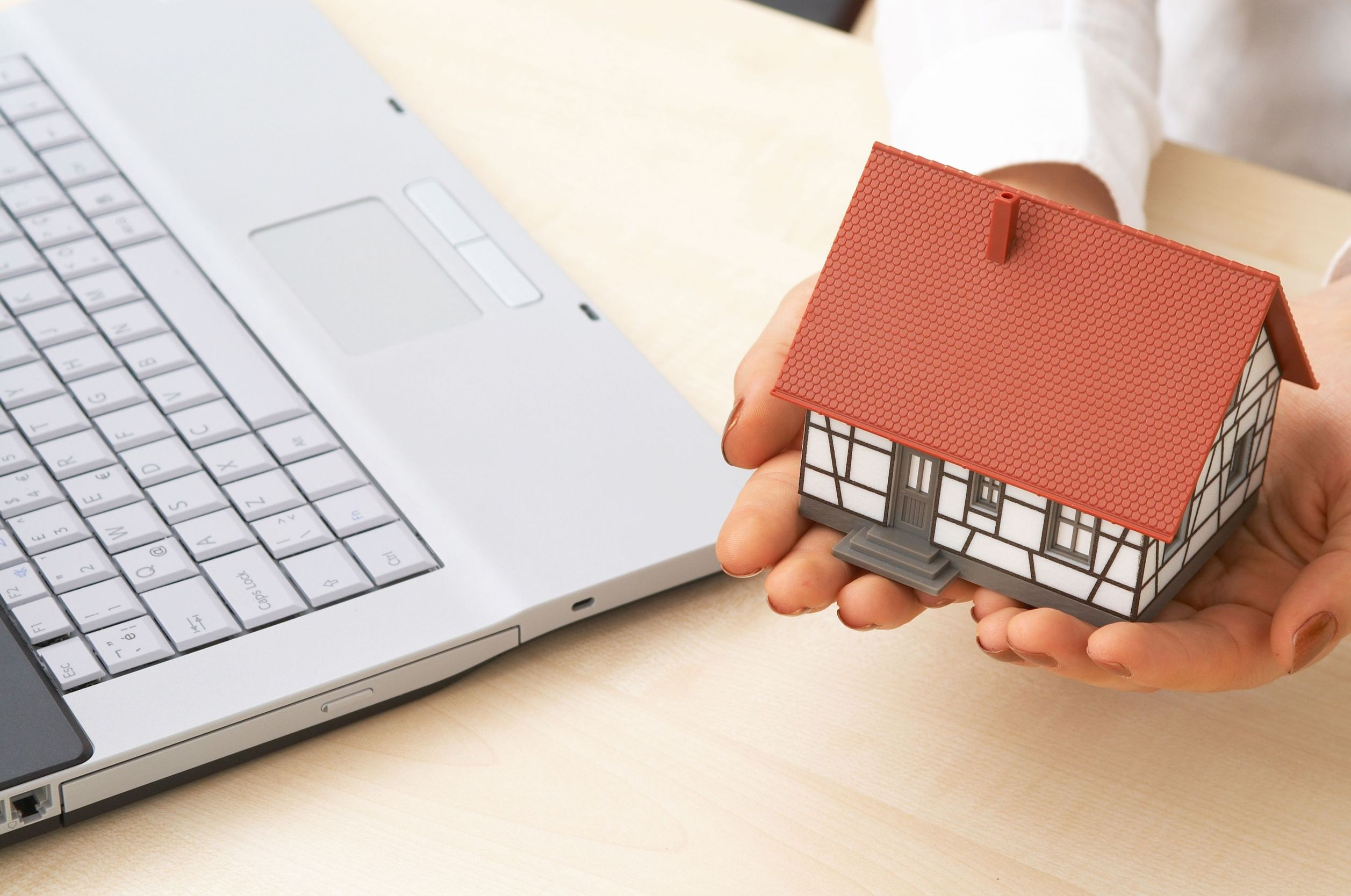 2010975 - real estate concept with a house and modern laptop