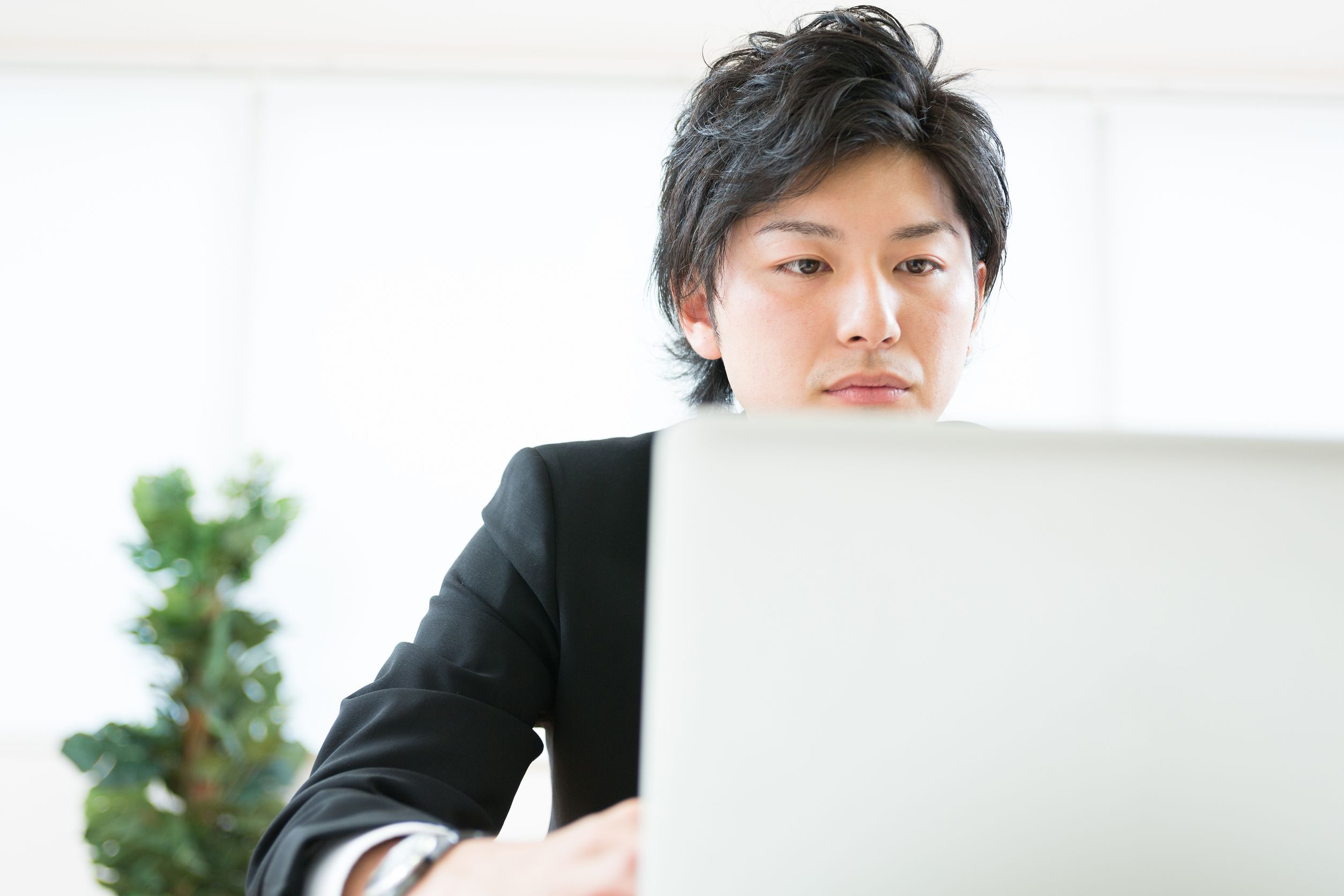 20587570 - young businessman using computer