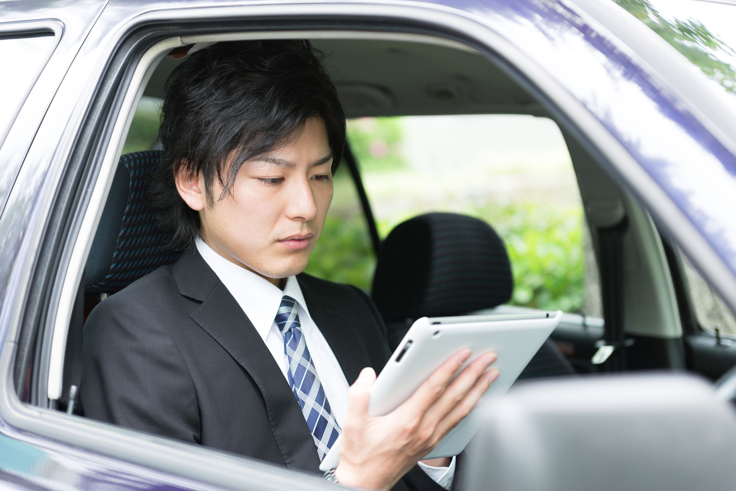 20588068 - young businessman in a car