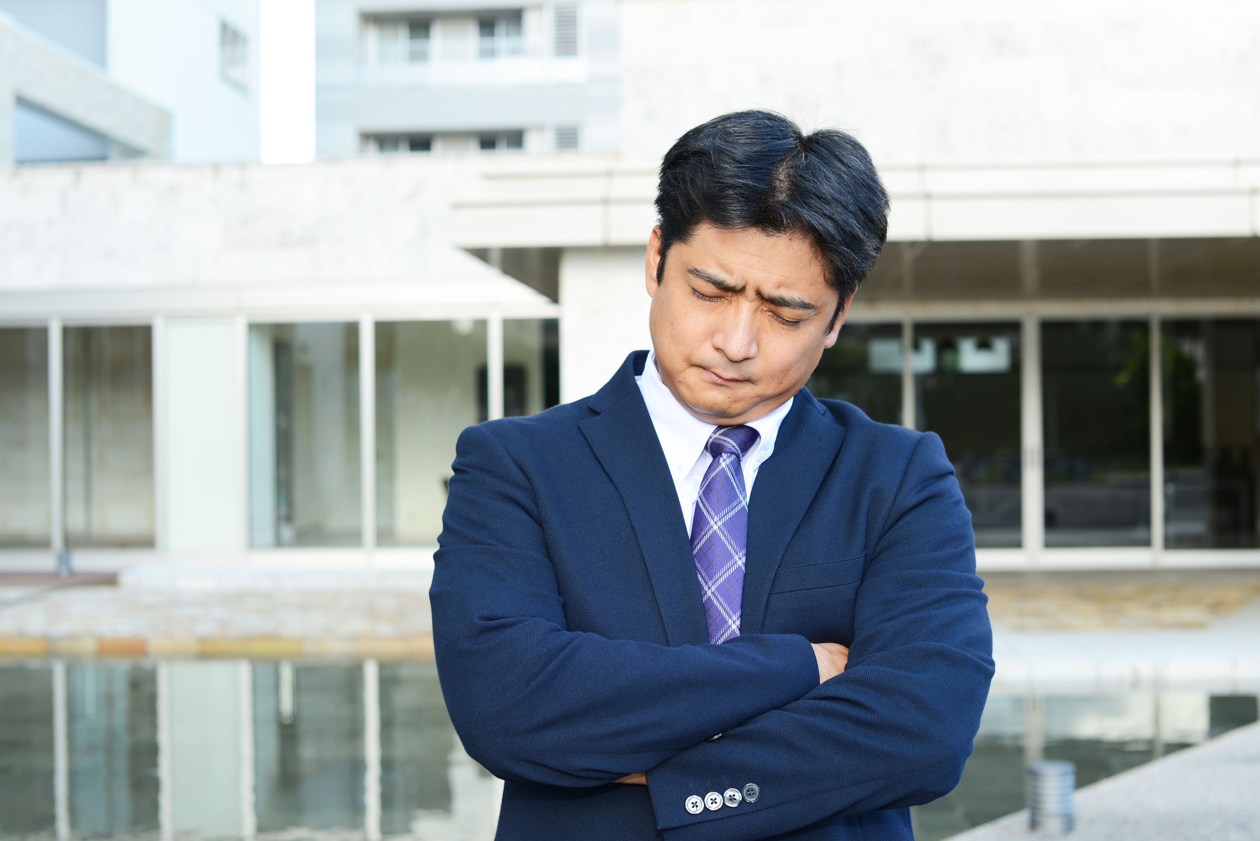 34714521 - depressed asian businessman