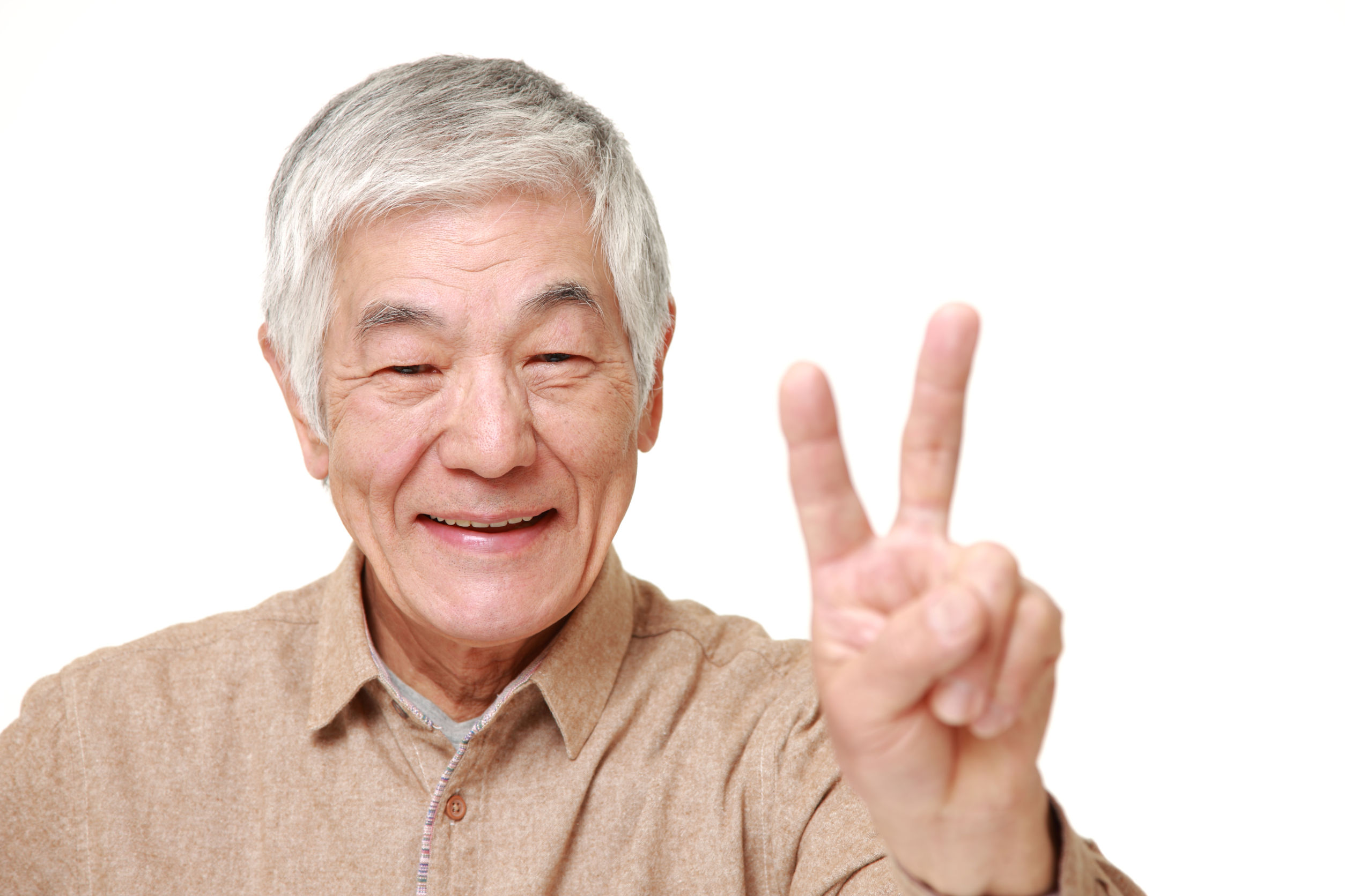 36869533 - senior japanese man showing a victory sign
