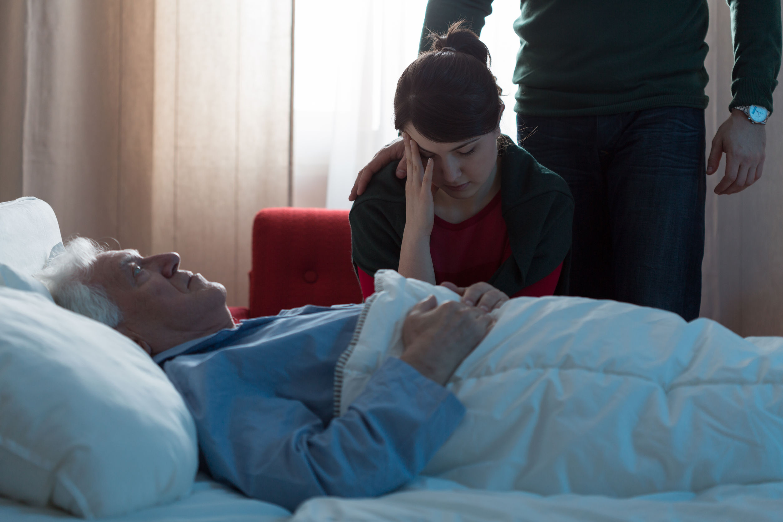 42076439 - young daughter depressed after her father's death in hospital