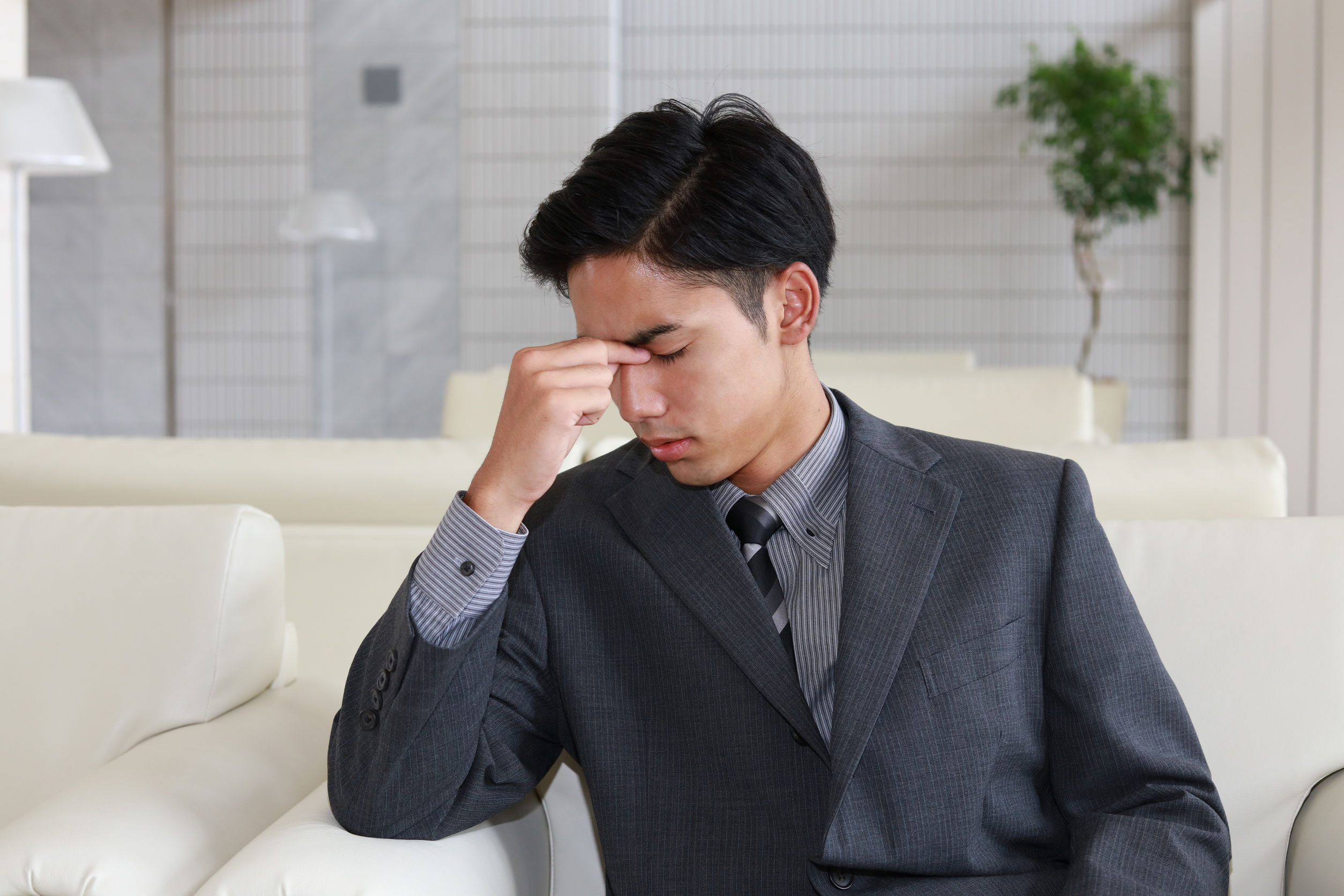 42376068 - tired and stressed asian businessman