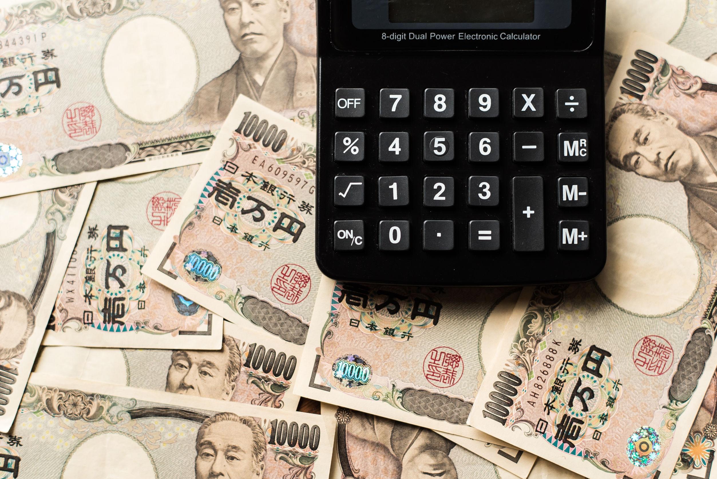 42758567 - calculater and ten thousands japanese yen