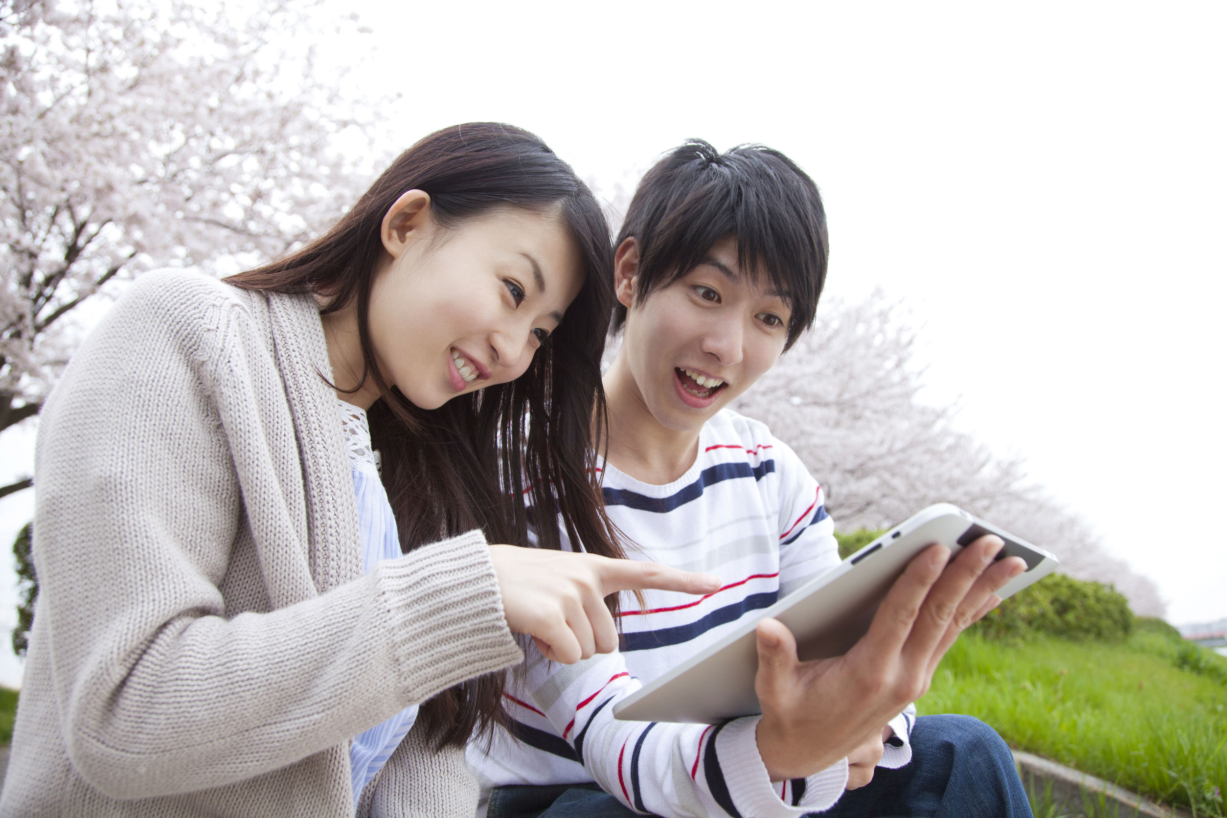 44473000 - couple of smile that touch the tablet pc