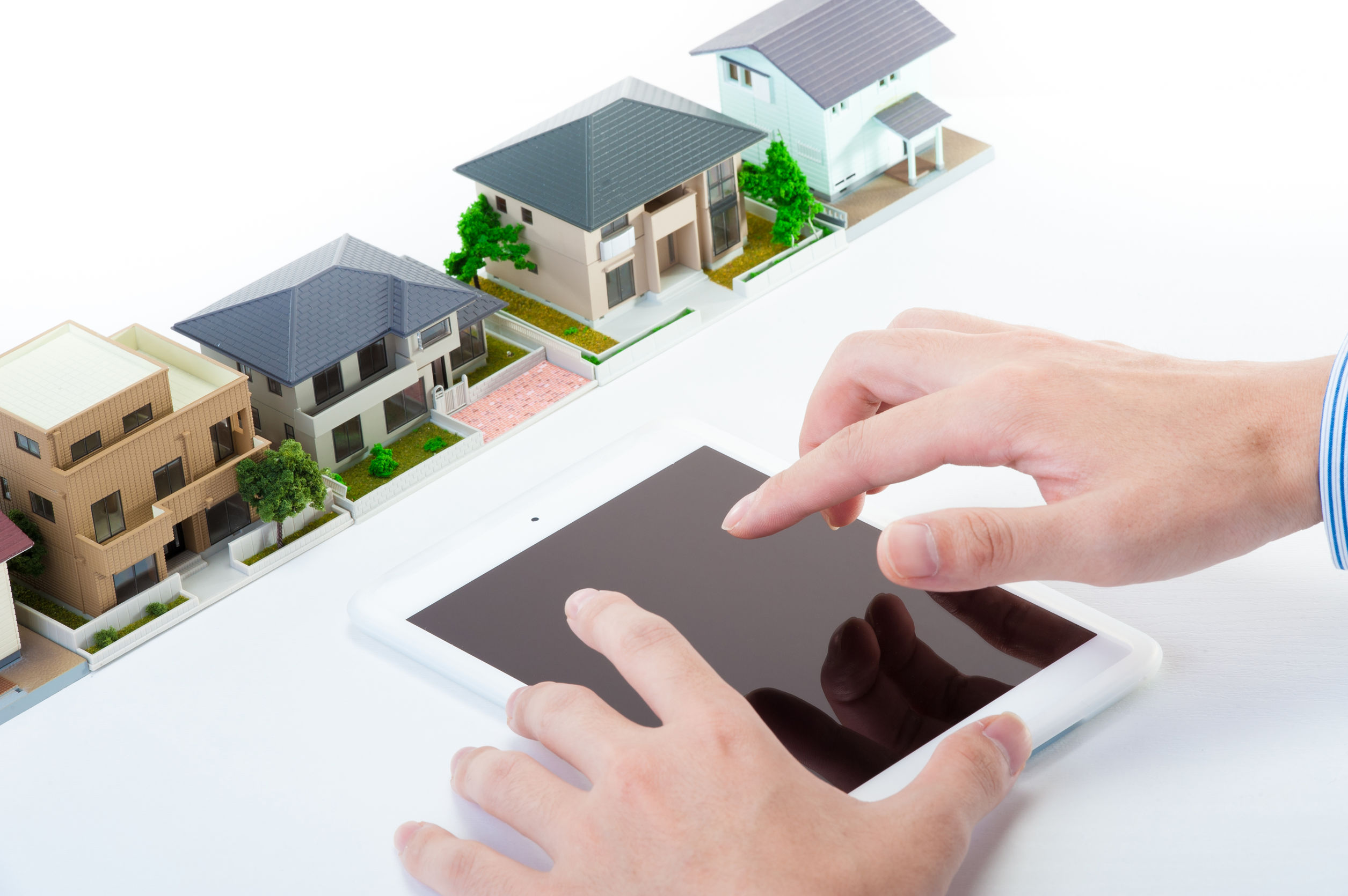 48613706 - house selling concept with housing, tablet smartphone