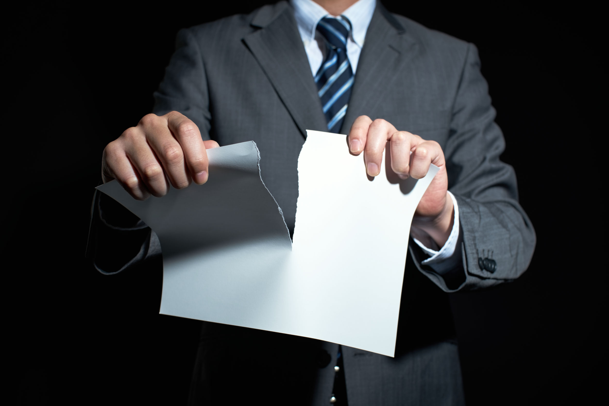 50399105 - businessman tear paper concept for breaking contract