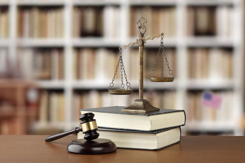 58812285 - gavel and scales of justice and law books on desk in law office