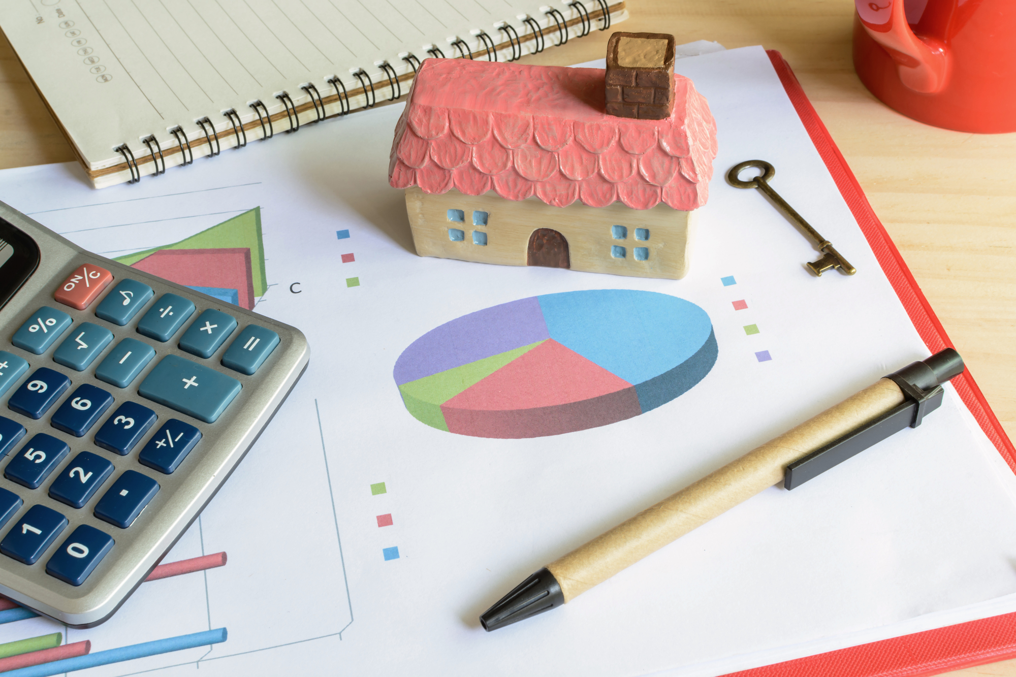 Home finance concept, residential house, expenses calculated
